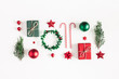 Leinwanddruck Bild - Christmas composition. Gifts, fir tree branches, red decorations on white background. Christmas, winter, new year concept. Flat lay, top view