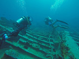 Scuba Divers on wreck of RMS Rhone - 231563599