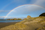 beach with rainbow fair weather