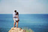 Young couple look at sea - 231579306