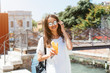 Beautiful young woman eating healthy food on travel vacation