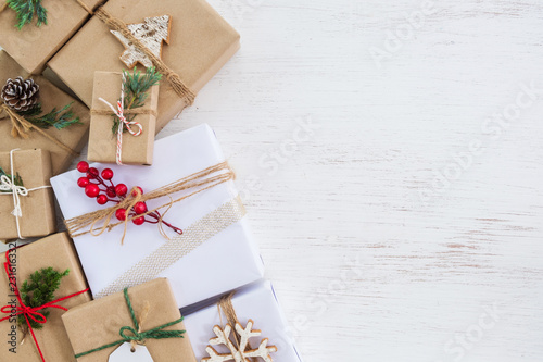 Christmas background - handmade present gift boxes with tag for Merry Christmas and New year holiday. Creative Flat layout and top view composition with border and copy space design. © jakkapan