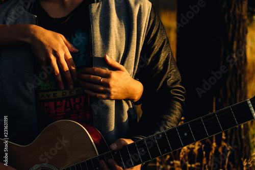 man playing guitar - 231631191