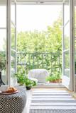 Vertical view of room with open balcony door, real photo - 231637933