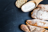 Assortment of baked bread on wooden table background - 231638982