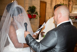 Mixed race wedding caucasian man and black woman interracial couple exchanging rings at ceremony church and say yes - 231653588