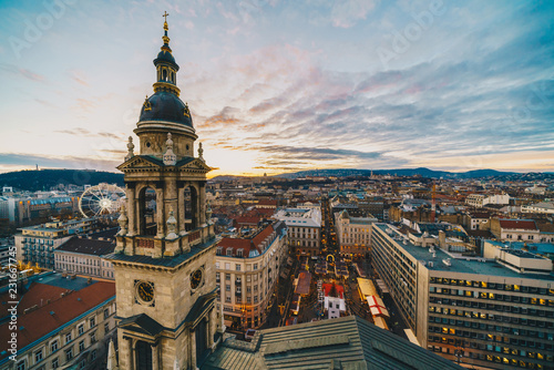 Leinwanddruck Bild Budapest as seen from the St Stephen Basilica tower with christmas market in front of the church
