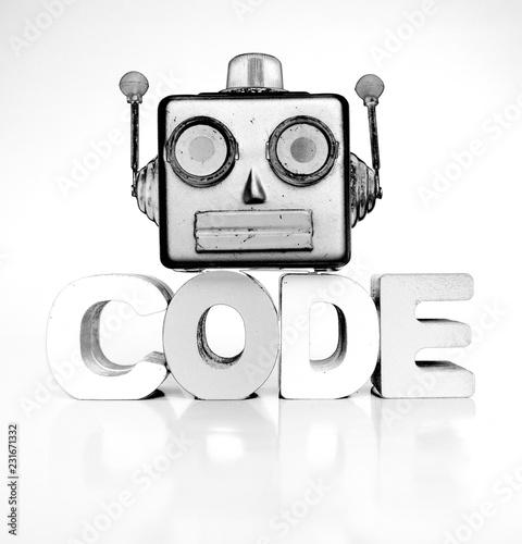 Leinwanddruck Bild monochrome robots head with the word code