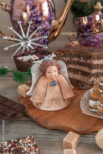 Wall mural Chocolate brown cupcake with walnuts, cinnamon and honey on the Christmas table