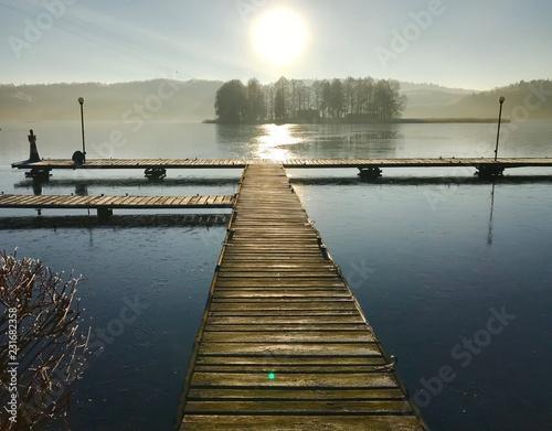 Acrylglas Pier pomost jezioro słońce zima