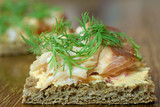 Delicious Canape with smoked arctic char, cream cheese and dill toppings on rye bread. - 231684790