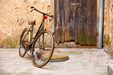 Old retro bicycle on vintage street in Croatia background aged - 231691347