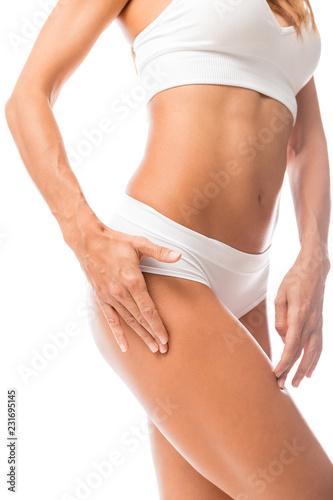 Leinwandbild Motiv Woman Checking Fat On Her Thigh