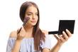 Leinwanddruck Bild - Young woman applying make-up