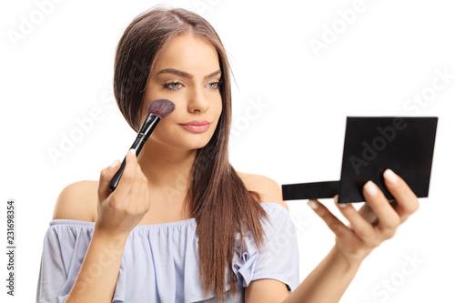 Leinwanddruck Bild Young woman applying make-up