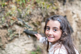 Beautiful young girl happy smiling along a mountain trail in autumn - 231700910