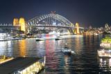 Sydney Harbor Bridge at night from Circular Quay, Australia - 231702307