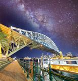 Night view of Sydney Harbor Bridge with stars and milky way, Australia - 231702322