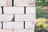 Pallet of bricks close-up for building a house in the country - 231703399