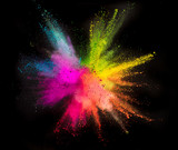 Colored powder explosion on black background. - 231703933
