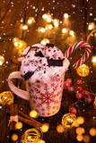 Christmas cup with hot chocolate and whipped cream. - 231704141
