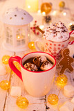 Cup with hot chocolate and marshmallows on old wooden table. - 231704192