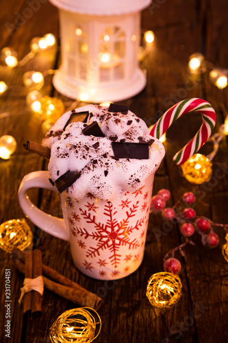 Christmas cup with hot chocolate and whipped cream. - 231704151