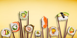 Traditional japanese sushi pieces placed between chopsticks, separated on pastel background. - 231704504