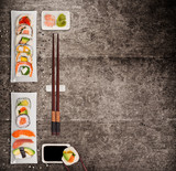 Traditional japanese sushi pieces on rustic concrete background. - 231704553