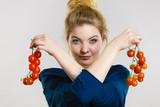Woman holding fresh cherry tomatoes
