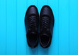 Men's sport shoes оn wood