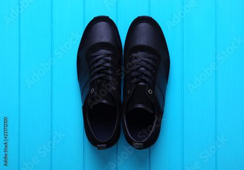 Sticker Men's sport shoes оn wood