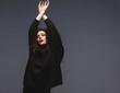 Stylish female fashion model in black