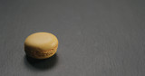 orange macaron on slate board - 231715988