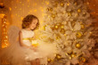 Leinwanddruck Bild - Child Dream under Christmas Tree, Happy Girl with Candle Sitting in Fantasy Night Decorated Room