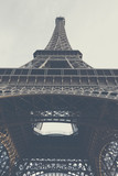 The Eiffel Tower - main tower and symbol of Paris, France.Low angle view.. Foggy. © Studio Dagdagaz