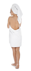 Young woman with soft towels on white background © New Africa