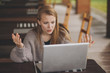 Frustrated worried young woman looks at laptop upset by bad news, teenager feels shocked afraid reading negative bullying message, stressed girl troubled with problem online or email notification.