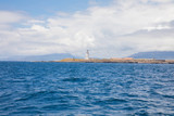 lighthouse of Tarifa town from Atlantic Ocean - 231743393