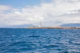 lighthouse of Tarifa town from Atlantic Ocean - 231743393