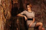 fashion model sitting on a stool