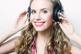 woman with headphones listening to music - 231749787
