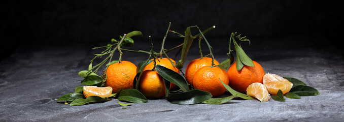 fresh ripe tangarines, food closeup on grey background © beats_