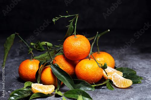 fresh ripe tangarines, food closeup on grey background - 231750762
