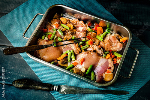 Foto Murales Prepared for baking chicken meat with vegetables.