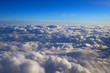 over cumulus clouds bright landscape view from the window of an airplane - 231758150