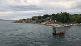 Picturesque seaview in the archipelago with pier boats and a swedish flag - 231759591