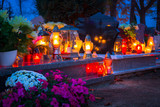 Colorful candles on the cemetery at All Saints Day, Poland - 231760340