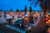 Colorful candles on the cemetery at All Saints Day, Poland - 231761729