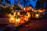 Colorful candles on the cemetery at All Saints Day, Poland - 231763767